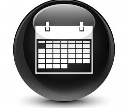 image of a black circle with a calendar in it
